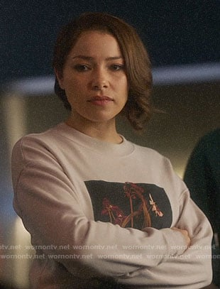 Nora's flower graphic sweatshirt on The Flash