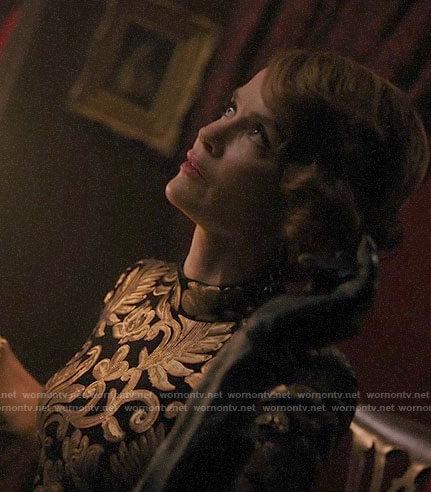 Penelope's black and gold patterned dress on Riverdale