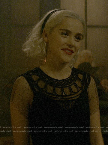 Sabrina's black mesh sleeve dress on Chilling Adventures of Sabrina