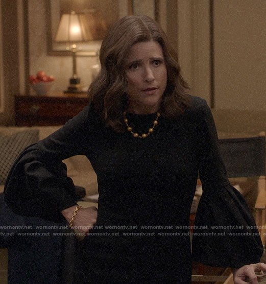 Selina's black bell-sleeve dress on Veep