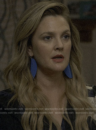 Sheila's blue earrings on Santa Clarita Diet