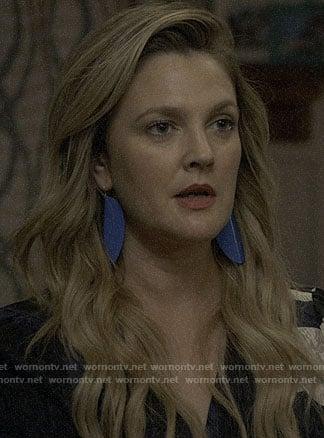 Sheila's blue earrings on Santa Clarita Diet