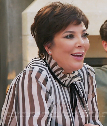 Kris's striped ruffle neck blouse on Keeping Up with the Kardashians