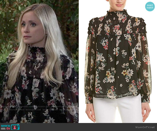 Vince Camuto Floral Story Smocked Mock Neck Blouse worn by Lulu Spencer Falconeri (Emme Rylan) on General Hospital