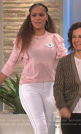 Eve's pink top and side stripe jeans on The Talk