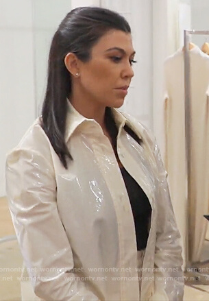 Kourtney's white vinyl blouse on Keeping Up with the Kardashians