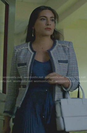Cristal's blue tweed jacket and pleated skirt on Dynasty