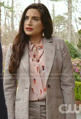Cristal's pink feather print blouse and grey plaid suit on Dynasty