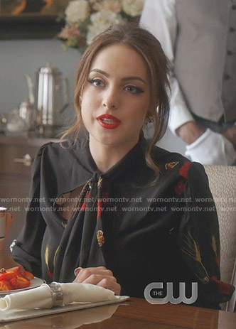 Fallon's black floral tie neck blouse on Dynasty