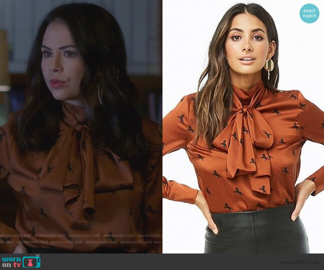 Horse Print Mock Neck Satin Top by Forever 21 worn by Mona Vanderwaal (Janel Parrish) on PLL The Perfectionists