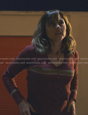 Judy's red ribbed v-neck top on Dead to Me