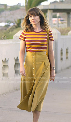 Judy's striped tee and yellow skirt on Dead to Me