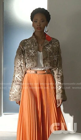 Monica's camo cropped jacket and orange pleated skirt on Dynasty