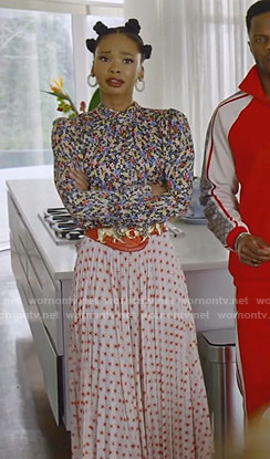 Monica's floral top and star print pleated skirt on Dynasty
