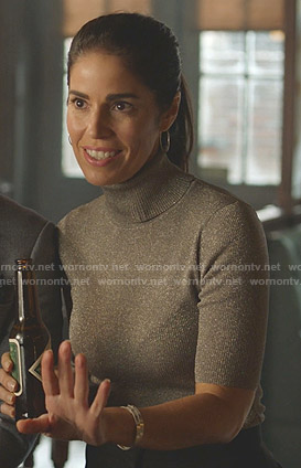 Susan's metallic turtleneck sweater on Whiskey Cavalier