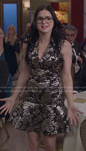 Alex's metallic patterned v-neck dress on Modern Family