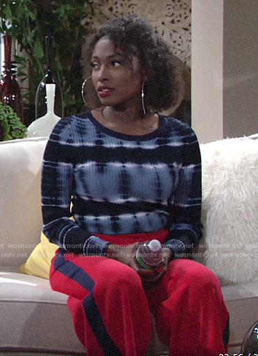 Ana's blue tie-dye sweater and red cropped pants on The Young and the Restless