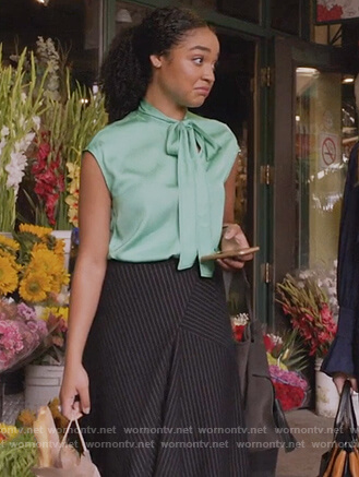 Kat's green tie neck top and pinstripe skirt on The Bold Type