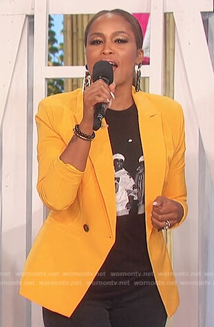 Eve's yellow blazer and print tee on The Talk