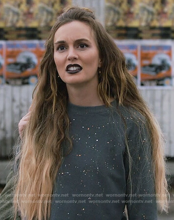Angie's black splatter sweater on Single Parents