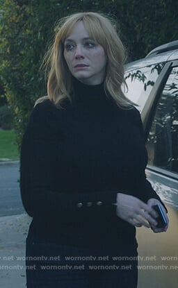 Beth's black turtleneck top with button cuffs on Good Girls