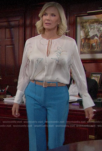 Brooke's white floral blouse and blue trousers on The Bold and the Beautiful