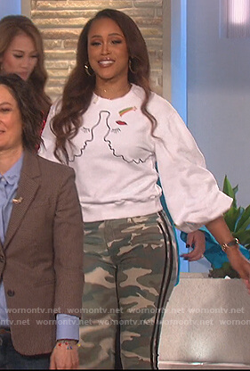 Eve's embroidered sweater and camo pants on The Talk