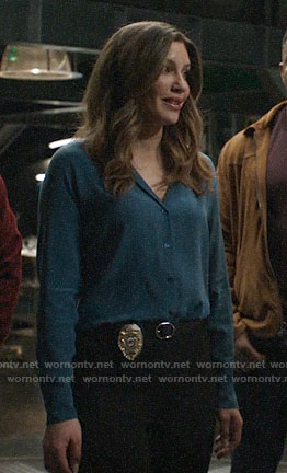 Dinah's teal button down blouse