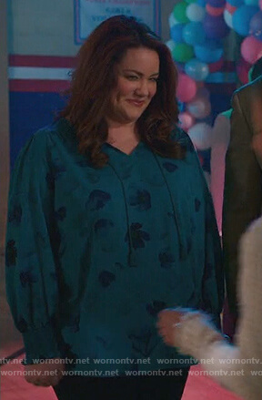 Katie's green floral print blouse on American Housewife