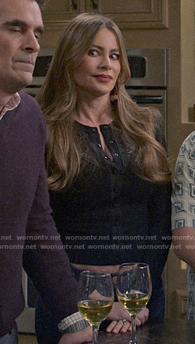 Gloria's black lace panel cardigan on Modern Family