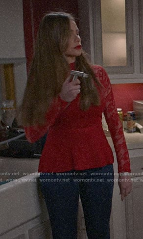 Gloria's red lace-sleeve peplum top on Modern Family