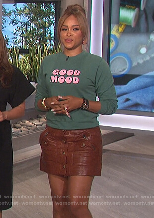 Eve's green Good Mood sweater on The Talk