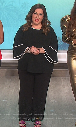 Carnie Wilson's black contrast top and lace hem pants on The Talk