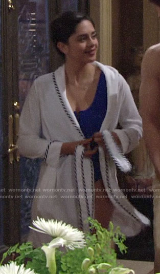 Lola's blue zip front swimsuit and striped trim robe on The Young and the Restless