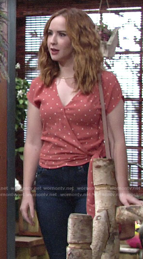 Mariah's orange polka dot wrap top on The Young and the Restless