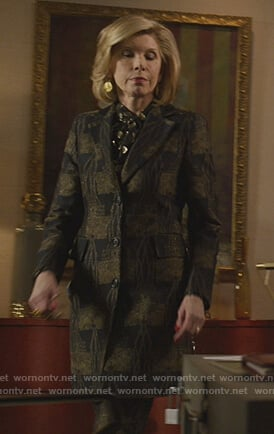 Diane's brown check coat and blouse on The Good Fight