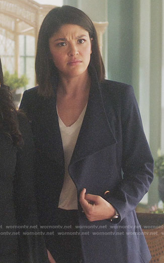 Niko's short navy coat on Charmed