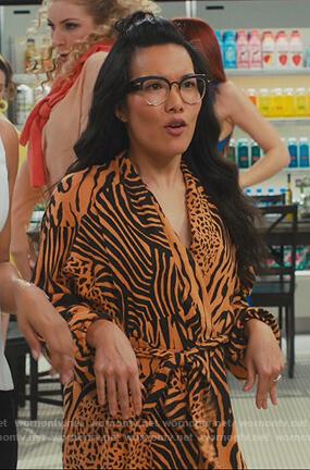 Doris's orange printed jumpsuit on American Housewife