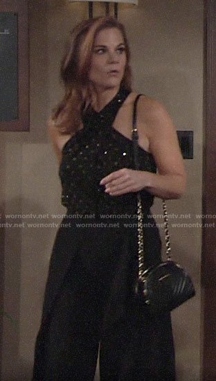 Phyllis's black embellished cross neck top and ruffled pants on The Young and the Restless