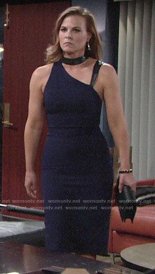 Phyllis's navy asymmetric dress with leather straps on The Young and the Restless