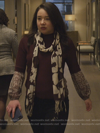 Marissa's red printed cuffs sweater on The Good Fight