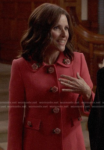 Selina's pink coat with rose buttons on Veep