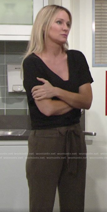 Sharon's black v-neck top and olive green pants on The Young and the Restless