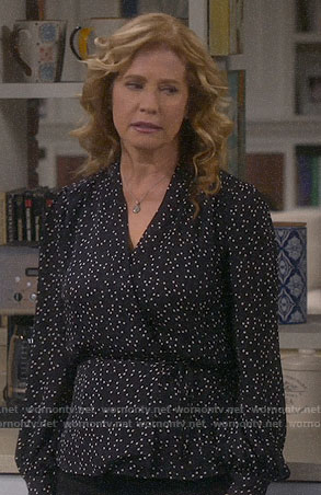 Vanessa's black polka dot wrap top on Last Man Standing