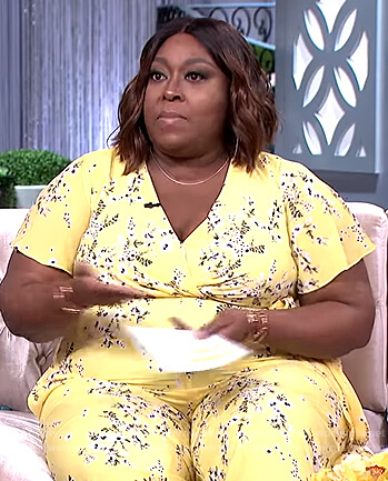 Loni's yellow floral print jumpsuit on The Real