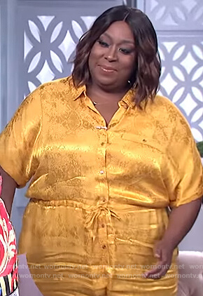 Loni's yellow metallic print jumpsuit on The Real