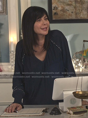 Cassie's navy studded v-neck top  on Good Witch