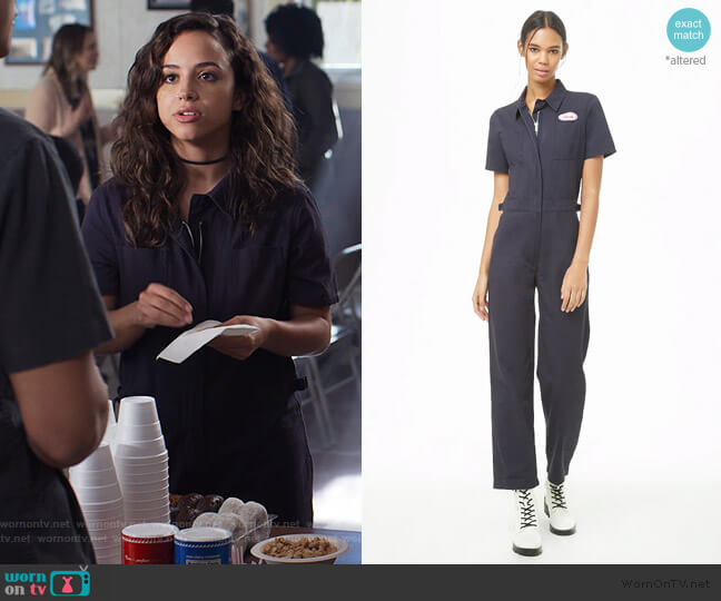 Patch Graphic Zip-Front Utility Jumpsuit by Urban Outfitters worn by Moe Truax (Kiana Madeira) on Trinkets