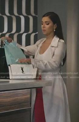 Gigi's white chain shoulder bag on Grand Hotel