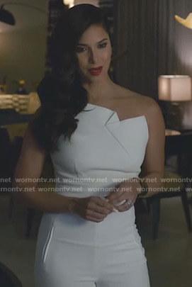 Gigi's white one-shoulder jumpsuit on Grand Hotel